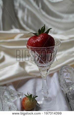 red fresh ripe sweet big strawberry in crystal wine glass for  romantic dessert