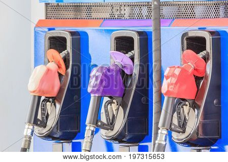Fuel pumps/Fuel nozzle at gas station in Thailand Closed up
