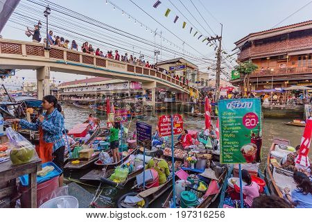 SAMUT SONGKHRAM, THAILAND - JANUARY 25, 2015: Trader's boats in Amphawa floating Market 110 km from Bangkok most famous floating market and cultural tourist destination in Amphawa Thailand.