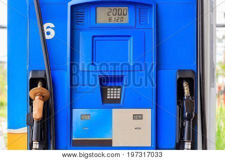 Close up of colorful fuel pumps/Fuel nozzle at gas station