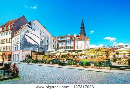 Street Open Air Cafe With People On Dome Square Riga