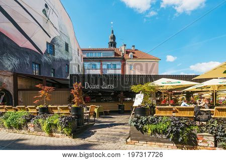Street Open Air Cafe With People At Dome Square Riga