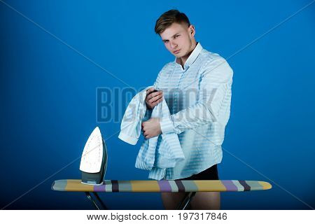 Man With Laundry For Ironing