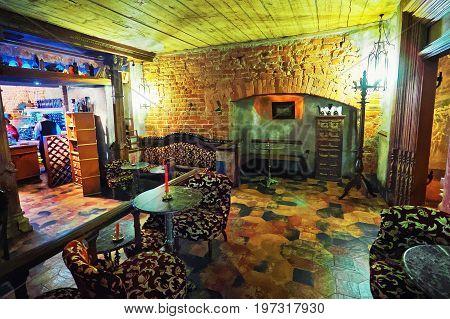 Riga Latvia - September 3 2014: Black magic bar interior in the historical center of Old town of Riga Latvia