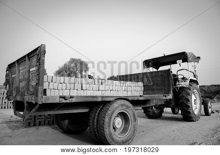Amritsar, Punjab, India - 21 April 2017 : Monochrome Picture Of Bricks Being Loaded On A Truck By A