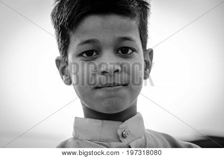 Jama Masjid, Old Delhi, India - 24 June 2017 : Monochrome Picture Of Portrait Of A Cute Indian Boy W