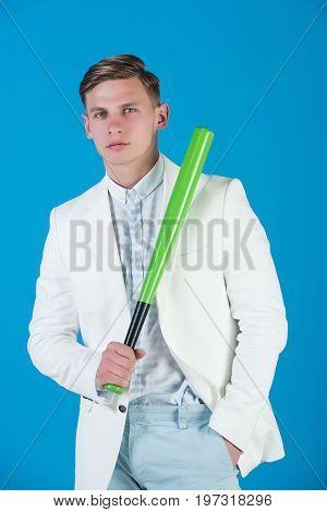 Baseball Player Posing On Blue Background