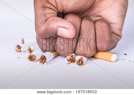 conceptual photo showing crushing of cigarette to express dangers of smoking