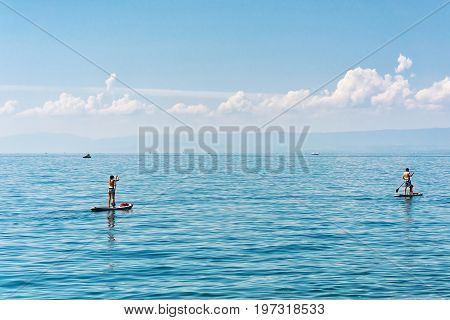 Montreux Switzerland - August 27 2016: People with Standup paddle surfing board on Geneva Lake in Montreux Swiss Riviera