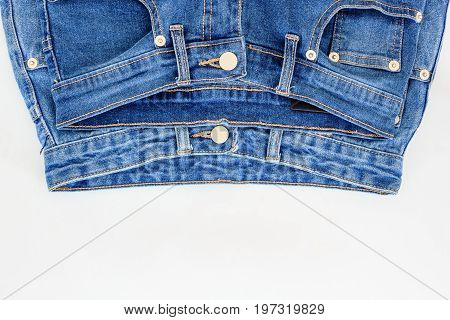 Pair of jeans.White background on which lie two pairs of jeans.