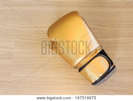 leather boxing gloves on a wooden background Top view with copy space and text.