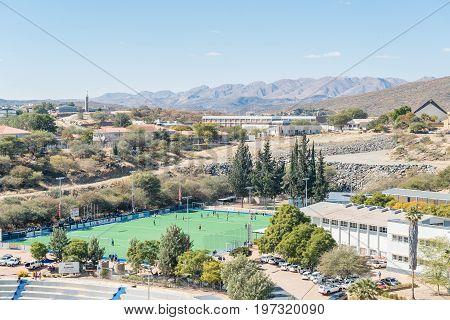 WINDHOEK NAMIBIA - JUNE 17 2017: Aerial view of the astroturf hockey field of Windhoek High School founded in 1917 in Windhoek the capital city of Namibia