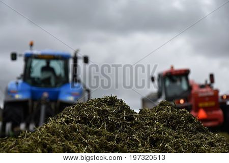 Tractor and loader in a silage pit