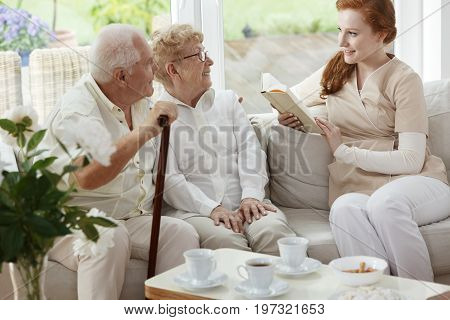 Pretty Caregiver Reads Book