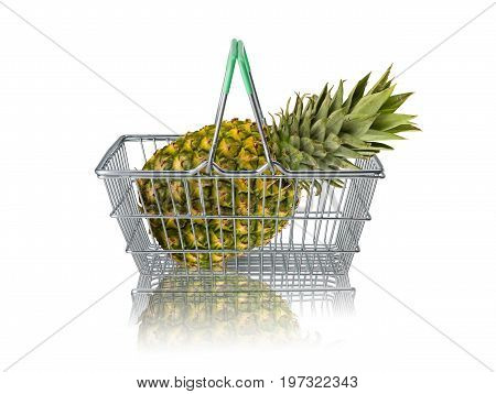 Organic pineapple in wire supermarket basket on white