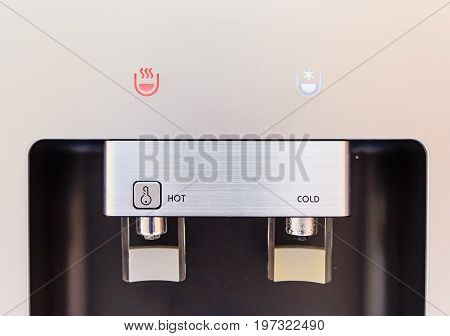 closed up of hot and cold faucet of water dispenser water cooler