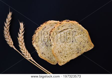 Organic Whole wheat,whole grains bread on black background with copy space