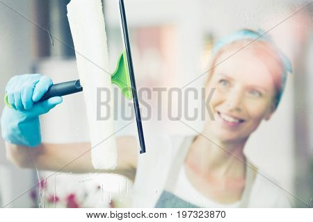 Blonde Woman Is Cleaning Window