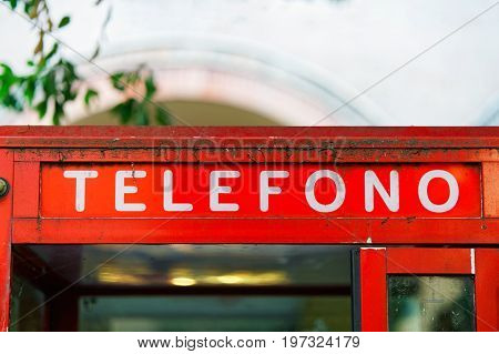 Fragment of red telephone box in Bologna Italy