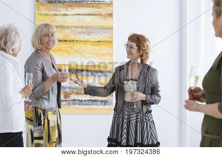 Happy Women At Art Gallery