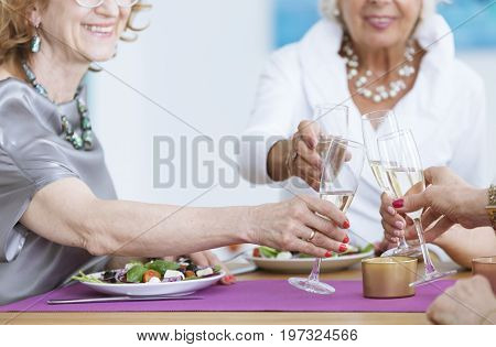Women With Glasses Of Champagne