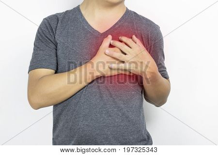 Man guy has heartache in gray clothe and hand touch with pain on white background