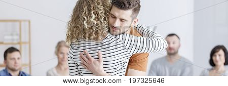 Couple Hugging Druing Therapy