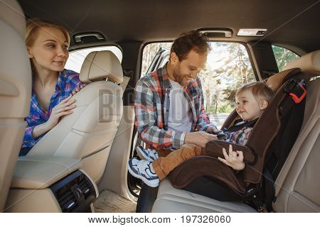 Travel by car family ride together child safety