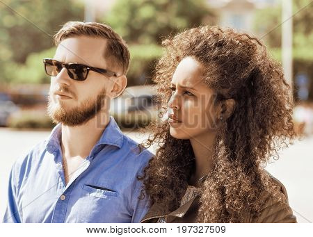 Young Multiracial Couple Look Serious And Frightened