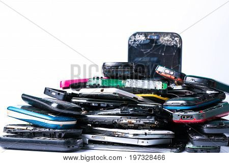 old mobile phone of electronics waste on isolated white background