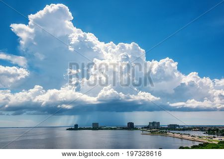 Large clouds over Tampa Bay and provide an afternoon shower