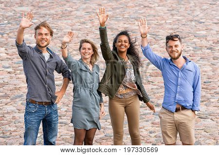 Group Of Young Friends Waving Their Hands