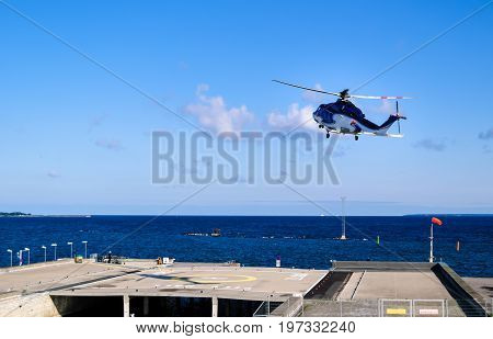 view on helicopter starting from helipad By Tallinn - Baltic sea