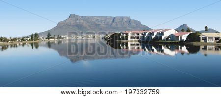FROM CAPE TOWN, SOUTH AFRICA, MILNERTON LAGOON, WITH THE SHADOW OF TABLE MOUNTAIN ON THE WATER