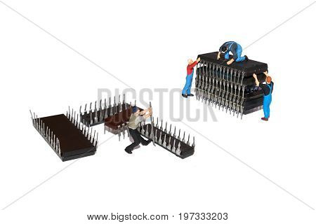 Creative concept with Miniature people. Team workers and microchips. Repair of machinery
