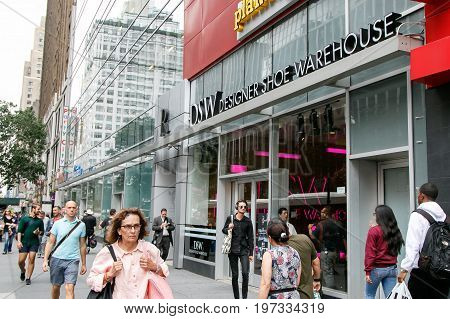 New York July 27 2017: People walk by a DSW store in Manhattan.