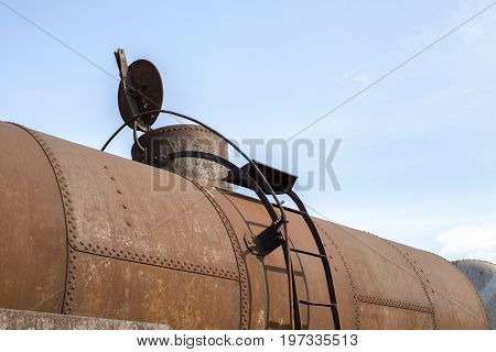 Part Of Rusty Railway Container With Opened Cap