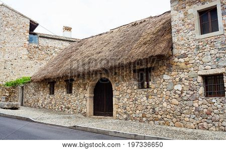 View of rural house with straw roof in Fagagna Italy