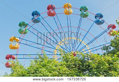 the Ferris wheel in the summer morning