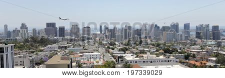 SAN DIEGO, CALIFORNIA, JUNE 7. Downtown on June 7, 2017, in San Diego, California. A Jet Airliner on Approach Over Downtown San Diego California.