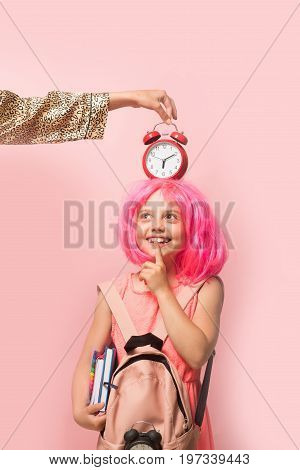 Back To School Concept. Girl With Wig In Pink Dress