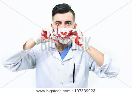 Surgeon With Hands In Blood And Syringe