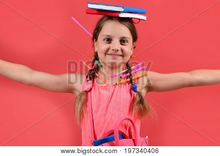 Back To School And Homework Concept. Pupil In Pink Dress