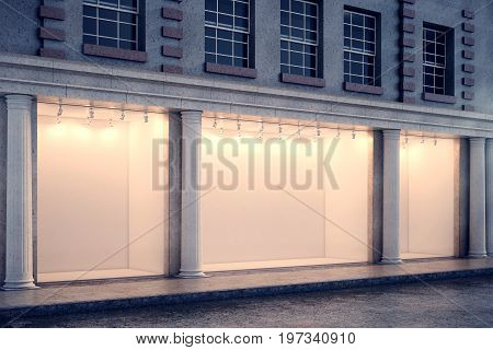 Side view of building with illuminated clear glass storefront and columns in night city. Advertisement and commerce concept. Mock up 3D Rendering