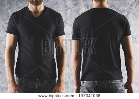 Shirt design and people concept. Close up of boy in blank black t-shirt front and rear view. Clean empty mock up template for your design. Concrete background