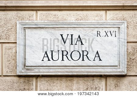 Via Aurora Street Sign On Wall In Rome