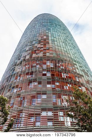BARCELONA, SPAIN - MAY 8, 2017: Modern skyscraper building wall Barcelona, Spain. Tower Torre Agbar skyscraper