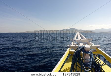 Front Of Yellow Boat With Blue Rope Heading Early In The Morning Towards A Tropical Island To Relax
