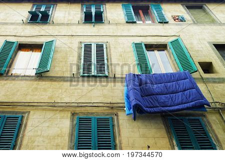Traditional House With Hanging Blanket On Clothesline In Siena