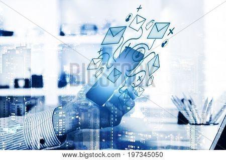 Male hand holding mobile phone with email letter network above workplace on abstract city background. E-mail communication social media concept. Double exposure